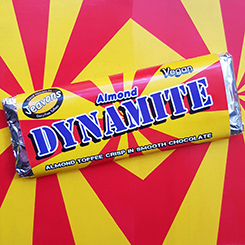 The Dynamite Bar, a thin 'buttery' almond crisp toffee wrapped in smooth chocolate.